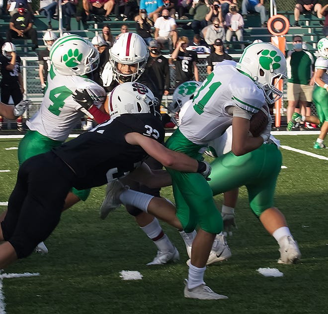 Mogadore's Chase Berkman is dragged down from behind by a University School defender during Saturday's game.