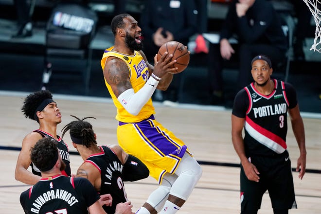 Los Angeles Lakers' LeBron James (23) scores against the Portland Trail Blazers during the second half Saturday in Lake Buena Vista, Fla. The Lakers won 131-122 to win the series 4-1. [AP Photo/Ashley Landis]