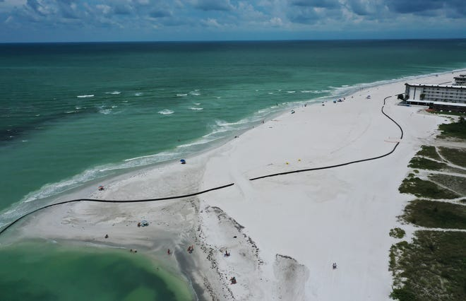 Beach renourishment continues on South Lido Key in Sarasota on Sunday. Sand is pumped in from Big Pass and is being distributed from south to north along the beach. [HERALD-TRIBUNE PHOTO / DAN WAGNER]