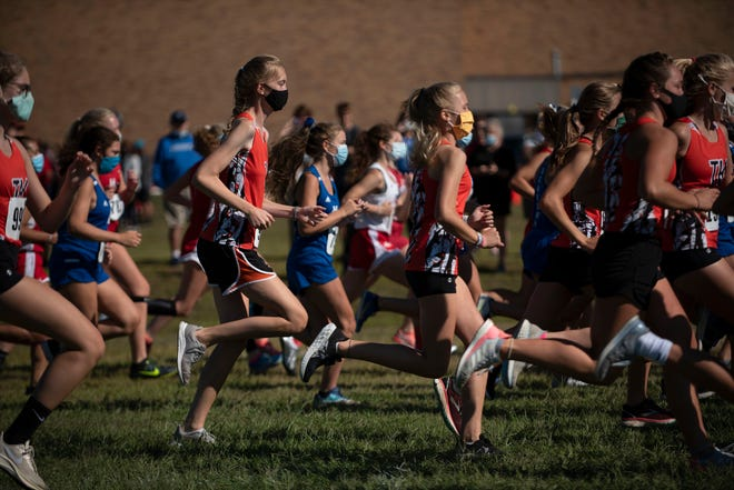 Harper Creek, Hanover-Horton and Middleville Thornapple Kellogg compete in the cross country Optimist Invitational on Saturday, Aug. 29, 2020 at Harper Creek High School in Battle Creek, Mich.