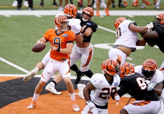 Cincinnati Bengals quarterback Joe Burrow makes a throw during a fight at Paul Brown Stadium on Sunday, August 30, 2020.