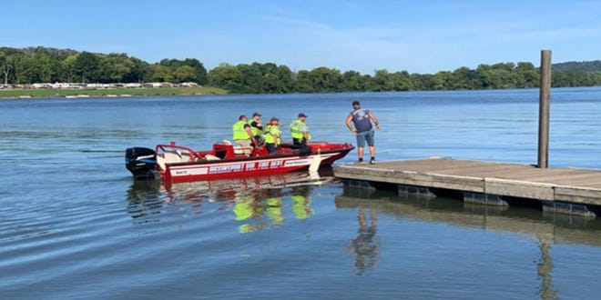 Rescue teams search for victims after boat crash in Ripley, Ohio.
