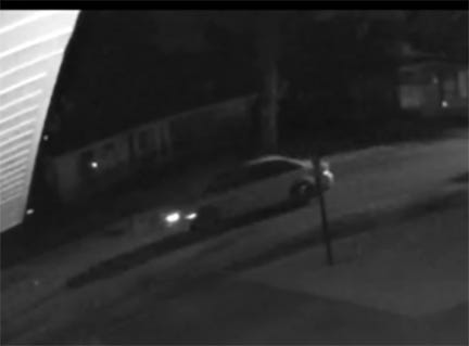 A surveillance video photo shows a car that Oakland County Sheriff's Office believes was involved in a drive-by shooting Saturday night that left three young children wounded.