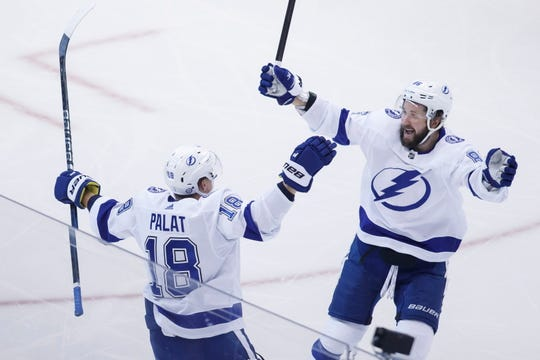 Tampa Bay Lightning left wing Ondrej Palat (18) celebrates his second goal of the game with teammate right wing Nikita Kucherov (86) during the second period.