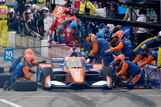 Scott Dixon pits during the IndyCar auto race at World Wide Technology Raceway on Saturday in Madison, Ill.
