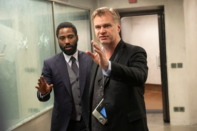 """(L-r) John David Washington and director/writer/producer Christopher Nolan on the set of Warner Bros. Pictures' action epic """"TENET,"""" a Warner Bros. Pictures release."""