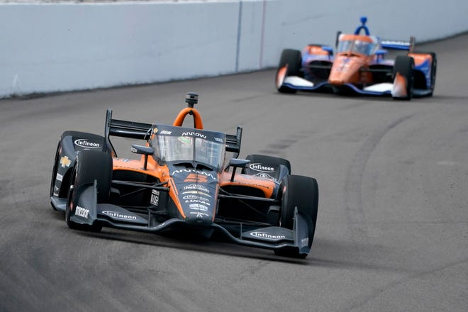 Pato O'Ward (5) drives into Turn 1 followed by Scott Dixon (9) during the IndyCar auto race at World Wide Technology Raceway on Sunday, Aug. 30, 2020, in Madison, Ill.