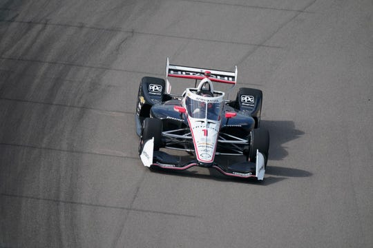 Josef Newgarden drives into Turn 1 during the IndyCar auto race at World Wide Technology Raceway on Sunday, Aug. 30, 2020, in Madison, Ill.