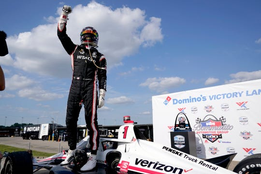 Josef Newgarden celebrates after winning an IndyCar auto race at World Wide Technology Raceway on Sunday, Aug. 30, 2020, in Madison, Ill.