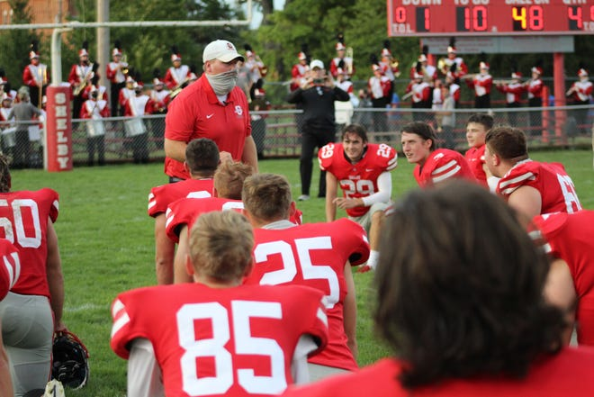 The Shelby Whippets practice social distancing as head coach Rob Mahaney addresses them after Friday's season-opening 28-14 win over Ontario