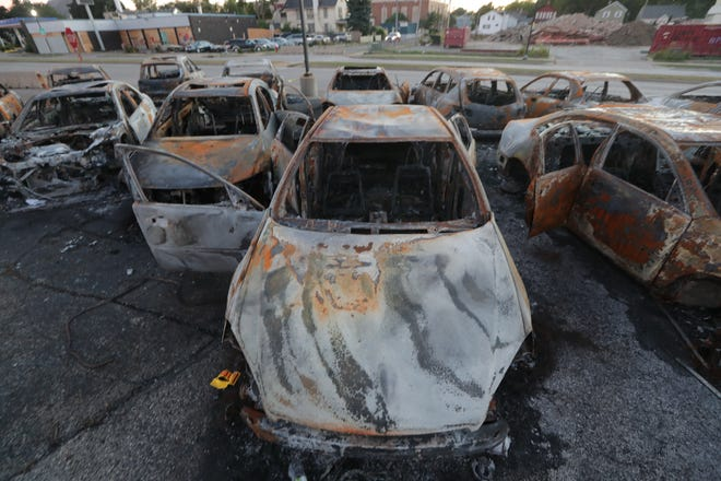 Burnt out cars are seen in a car lot near the Kenosha County Courthouse  in Kenosha on Saturday, Aug. 29, 2020.  The shooting of Jacob Blake seven times in the back by a Kenosha police officer during a domestic disturbance on Sunday, Aug. 23 has sparked several nights of unrest that included the death of two people and seriously injured another.  - Mike De Sisti / Milwaukee Journal Sentinel