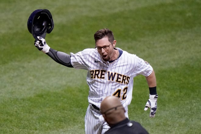 Eric Sogard gets ready to celebrate with his teammates at home plate after hitting a two-run, walk-off home run in the ninth inning Saturday at Miller Park.