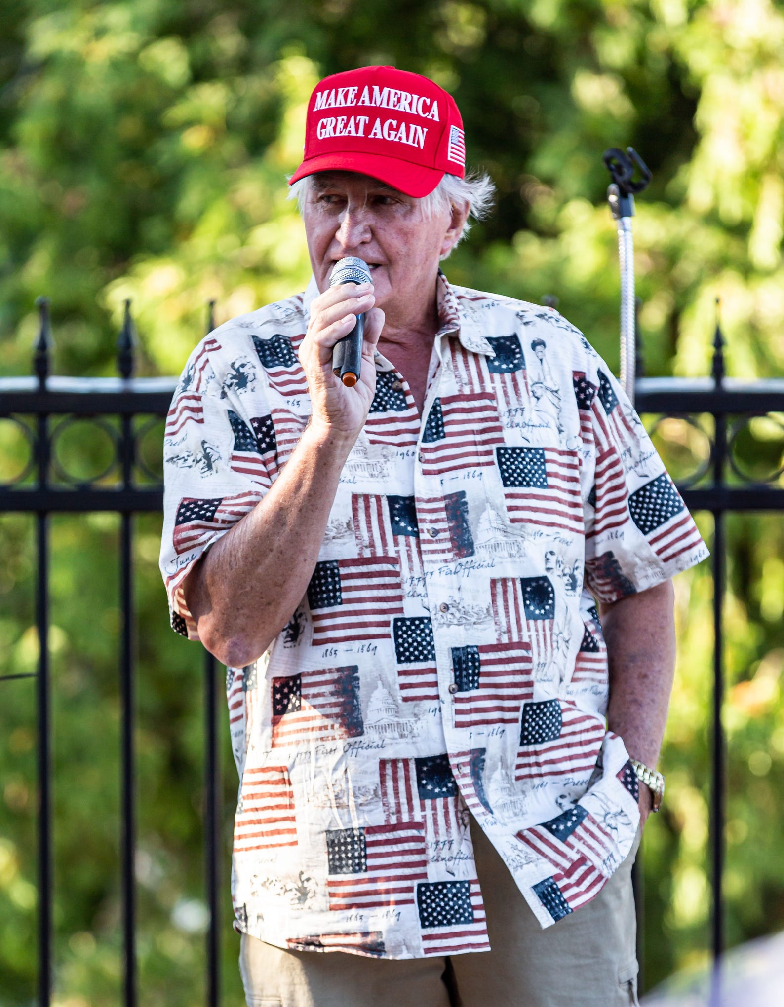 Hans Weissgerber Jr. addresses the crowd at The Golden Mast restaurant in Okauchee during a boat parade in support of President Trump on Saturday, August 29. The event was hosted by the Republican Party of Waukesha County.