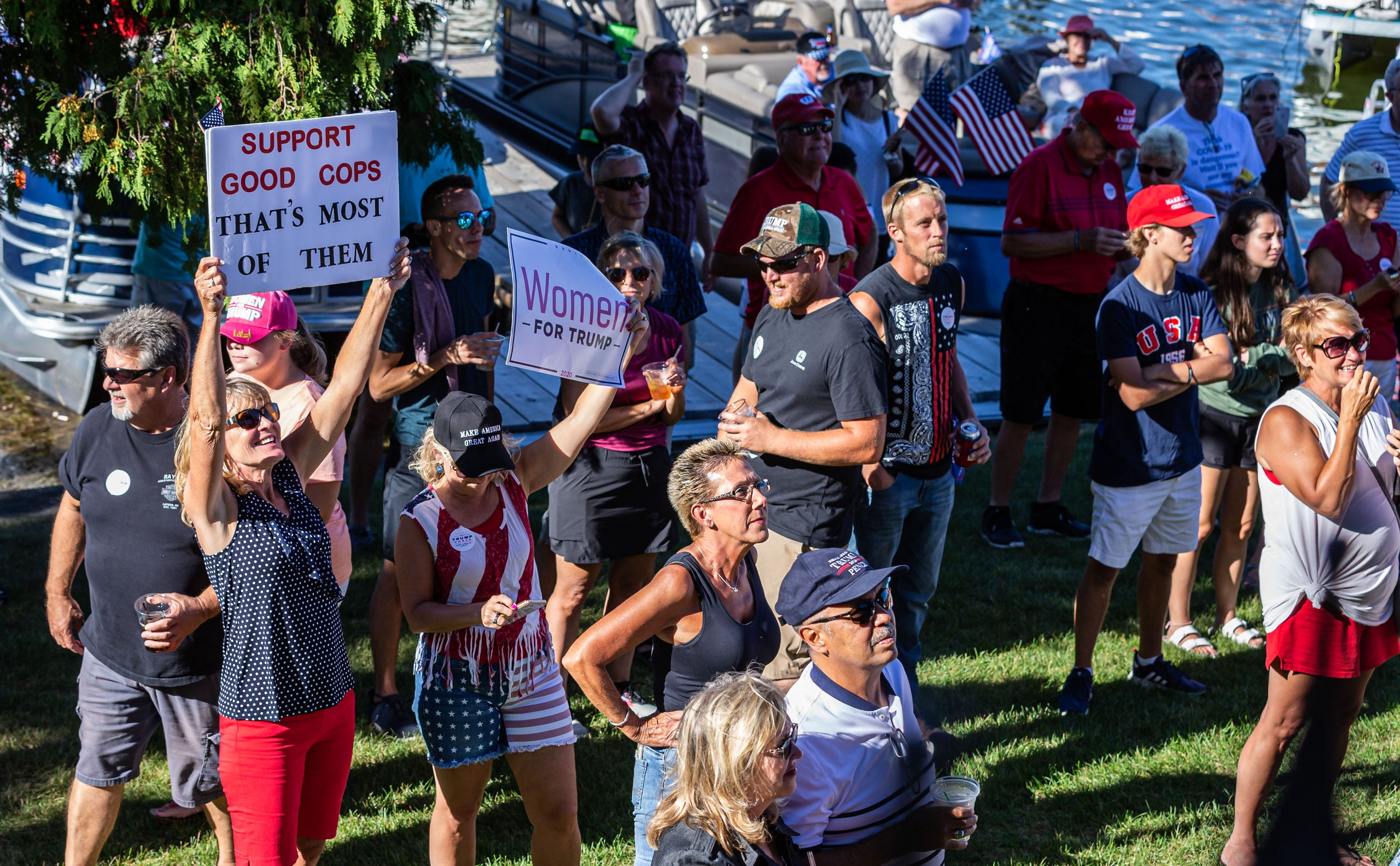 People gather at The Golden Mast restaurant in Okauchee during a boat parade in support of President Trump on Saturday, August 29. The event was hosted by the Republican Party of Waukesha County.
