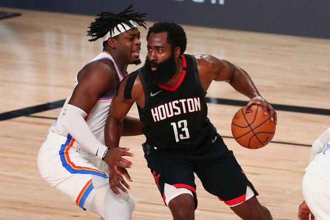 Houston Rockets guard James Harden (13) drives against Oklahoma City Thunder guard Luguentz Dort (left) during the second half of Game 4 of an NBA basketball first-round playoff series, Monday, Aug. 24, 2020, in Lake Buena Vista, Fla. (Kim Klement/Pool Photo via AP)