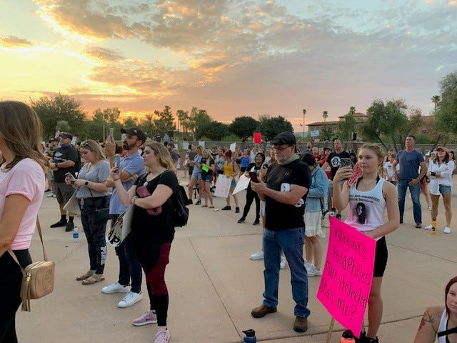 "A crowd of people gather at the ""Save the Children"" event in Phoenix on Aug. 29, 2020."