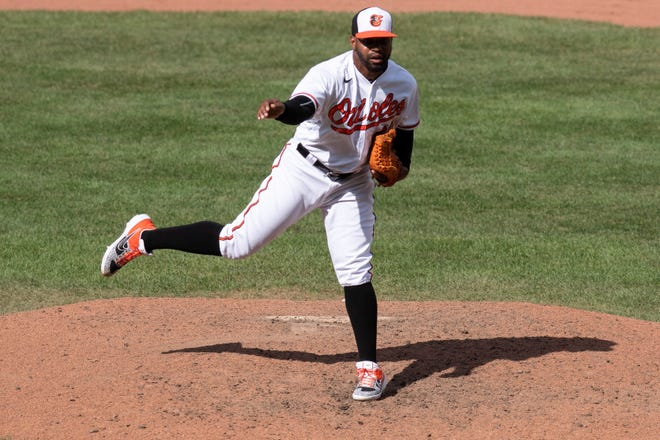 Baltimore Orioles relief pitcher Mychal Givens (60) delivers a pitch during a baseball game against the Boston Red Sox, Sunday, Aug. 23, 2020, in Baltimore. (AP Photo/Tommy Gilligan)