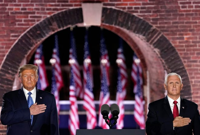 President Donald Trump, left, attends Mike Pence's acceptance speech for the vice presidential nomination during the Republican National Convention from Fort McHenry National Monument on Wednesday, Aug. 26, 2020, in Baltimore. (Drew Angerer/Getty Images/TNS)