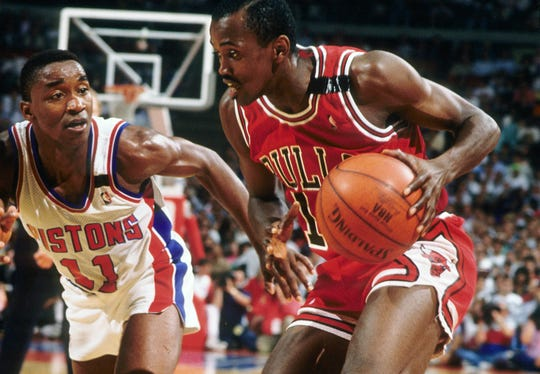Craig Hodges is defended by Isiah Thomas during a 1989 game between the Bulls and Pistons.