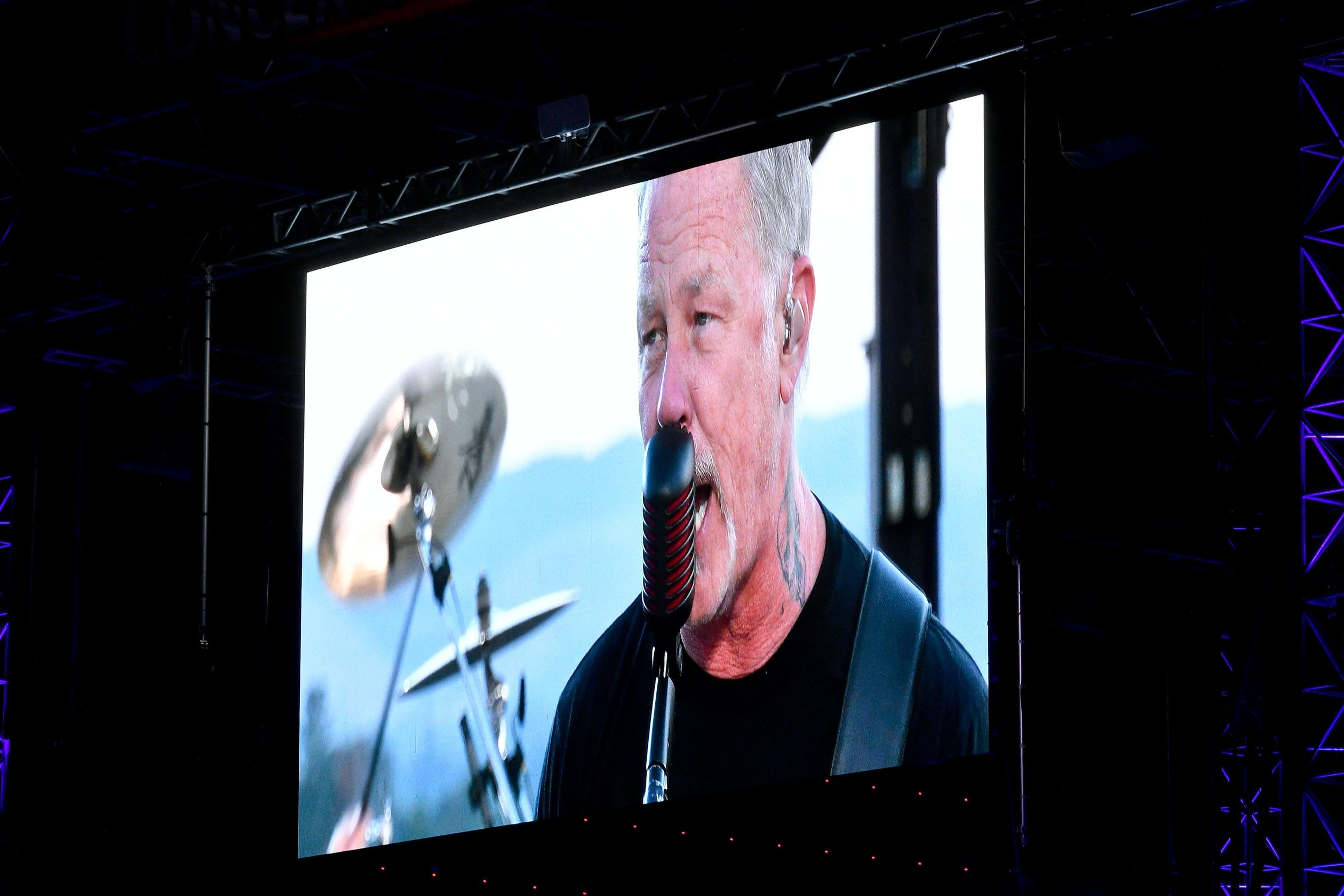 'Music helps us through all things': Metallica rocks virtual concert at drive-in theaters thumbnail
