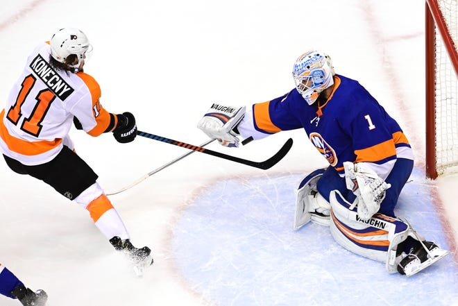 Flyers forward Travis Konecny is stopped by Islanders goalie Thomas Greiss during the NHL playoffs in August.