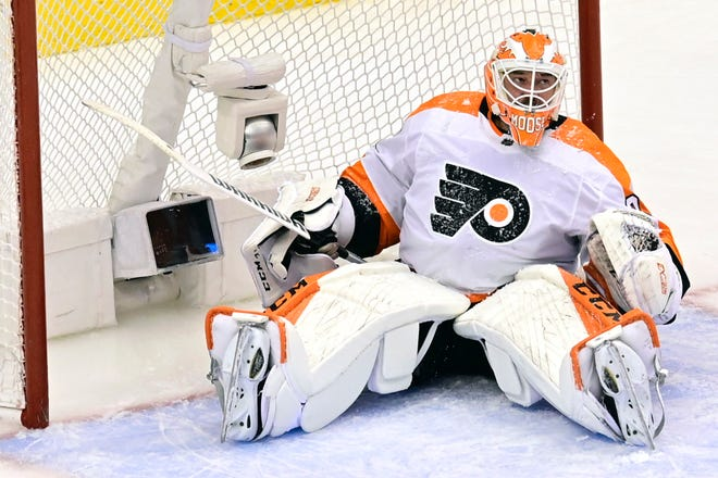Flyers goaltender Brian Elliott laments allowing a goal to the Islanders'  J-G Pageau, not shown, during the third period of Game 4 on Sunday night,