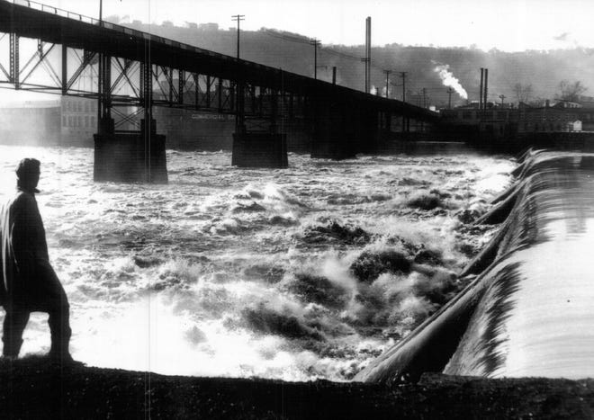 This 1936 view of the Beaver River shows the location of the original Middle Falls, with the old Tenth Street Bridge visible to the left. Along with the Upper and Lower Falls, the Middle Falls created an immense amount of waterpower for early industries in Brighton, the village that would someday become Beaver Falls.