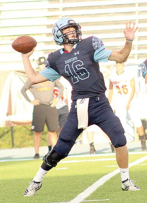 Bartlesville High School starting quarterback candidate Paxton Bradford gets ready to fire a red zone pass in last week's football scrimmage.