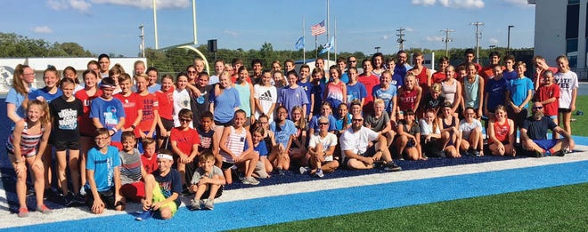 People of all ages gather for a group photo for the Bartlesville High Cross Country 9/11 Memorial Workout in 2019. This year's event is planned for Sept. 14 at Custer Stadium.