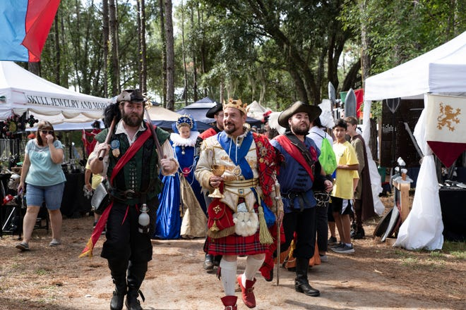 The king makes his way through the marketplace at the Lady of the Lakes Renaissance Faire on Friday, Nov. 1, 2019. [Cindy Peterson/Correspondent]
