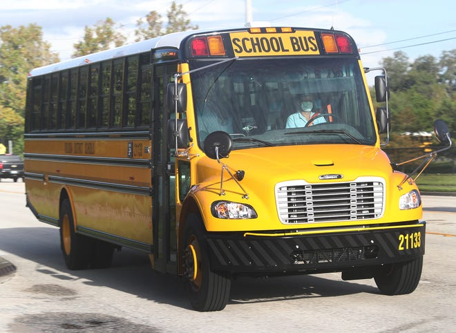 A school bus rolls down Taylor Road after it's drop off at Spruce Creek High, Monday August 31, 2020 on the first day of school in Volusia County.