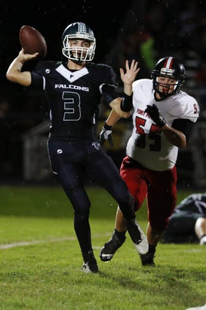 West Burlington-Notre Dame quarterback Drake Day looks to pass the ball while pressured by the Dalton Mabeus during the game against Fort Madison High School Sept. 16, 2016 at West Burlington's Bill Nelson Field.