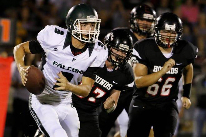 West Burlington-Notre Dame/Danville quarterback Drake Day (3) evades Fort Madison players during the game Sept. 15, 2017 at Fort Madison's Richmond Stadium.