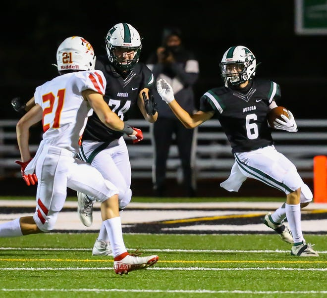 Aurora's Jack Cardaman (6) looks for a block from James Ingram (74) during the Greemen's 35-21 home loss to Brecksville-Broadview Heights Aug. 28. Cardaman returned a kickoff 88 yards for a touchdown in the loss.