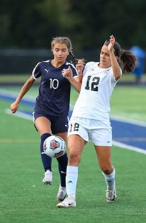 Twinsburg forward Emily Patrzyk battles for the ball with Cuyahoga Falls' Ameah McVan during a game last sason. Patrzyk scored two goals in each of Twinsburg's first two games, as the Tigers beat Nordonia 3-0 Aug. 26 and Mentor 4-3 Aug. 29.