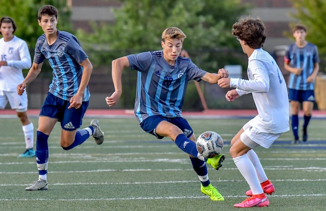 Hudson's Tyler Travis makes a move during the Explorers' 4-1 win over Uniontown Lake Aug. 29 at Hudson Memorial Stadium. The game was Hudson's season opener.