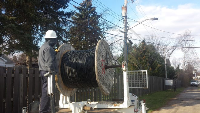 A Hudson Public Power employee is pictured running fiber-optic cable to power Velocity Broadband's Gigabit high-speed internet service to businesses. City Council has given Velocity permission to seek residential customers who are located more than 300 feet from the existing fiber line.