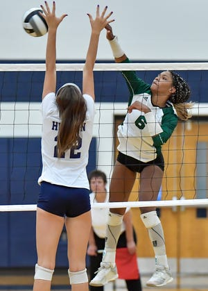 Nordonia outside hitter Joy Banks puts a kill down during a game against Hudson earlier last season. Banks finished with 23 kills in the Knights' 25-19, 25-23, 25-14 win at Copley Aug. 27.