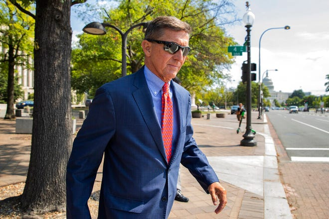 FILE - In this Sept. 10, 2019, file photo, Michael Flynn, President Donald Trump's former national security adviser, leaves the federal court following a status conference in Washington. The arrest of President Donald Trump's former chief strategist Steve Bannon adds to a growing list of Trump associates ensnared in legal trouble. They include the president's former campaign chair, Paul Manafort, whom Bannon replaced, his longtime lawyer, Michael Cohen, and his former national security adviser, Michael Flynn.