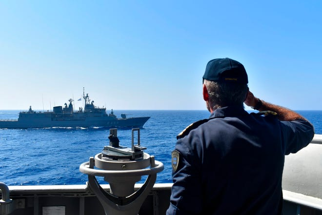 In this photo provided by the Greek Defense Ministry, Warships take part in a military exercise in Eastern Mediterranean Sea last month. Turkey is accusing France of stoking tensions in the eastern Mediterranean, where NATO allies Turkey and Greece are locked in a stiff standoff over competing claims over offshore energy exploration rights.