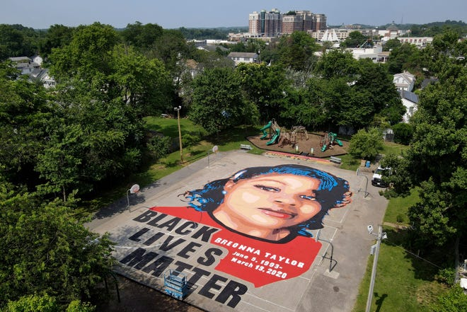 A ground mural depicting a portrait of Breonna Taylor is displayed July 6 at Chambers Park in Annapolis, Md.