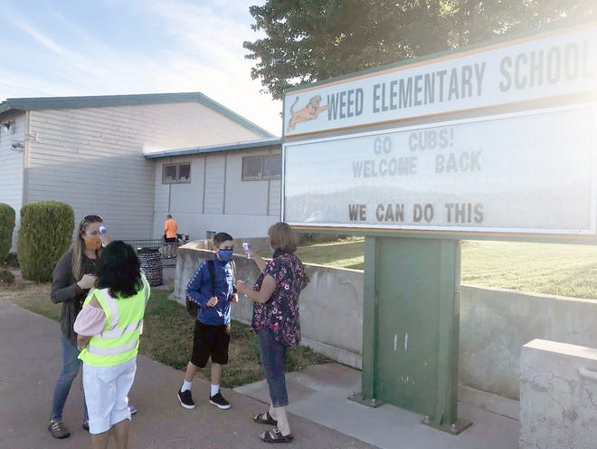 All who enter Weed Elementary School have their temperature checked on the first day, Aug. 31, 2020.