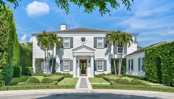 A house built in 2016 at 309 Dunbar Road on the North End of Palm Beach has changed hands for a recorded $9.887 million The buyers were Christopher A. and Margaret D. Sinclair, the deed shows. [Pelican Pix photo courtesy Premier Estate Properties]