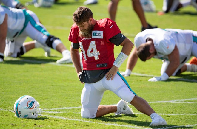 Dolphins quarterback Ryan Fitzpatrick says he will separate his personal hurt from the need to continue to mentor Tua Tagovailoa.