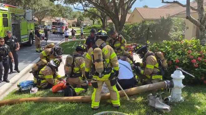 Palm Beach County Fire Rescue firefighters pulled two family dogs from a house fire Monday afternoon, saving one. [Photo provided by Palm Beach County Fire Rescue]