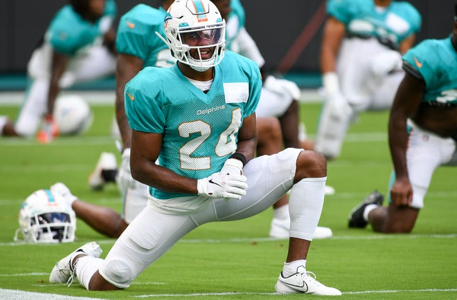 Miami Dolphins cornerback Byron Jones stretches before the scrimmage at Hard Rock Stadium. [JEFF ROMANCE/The Palm Beach Post]