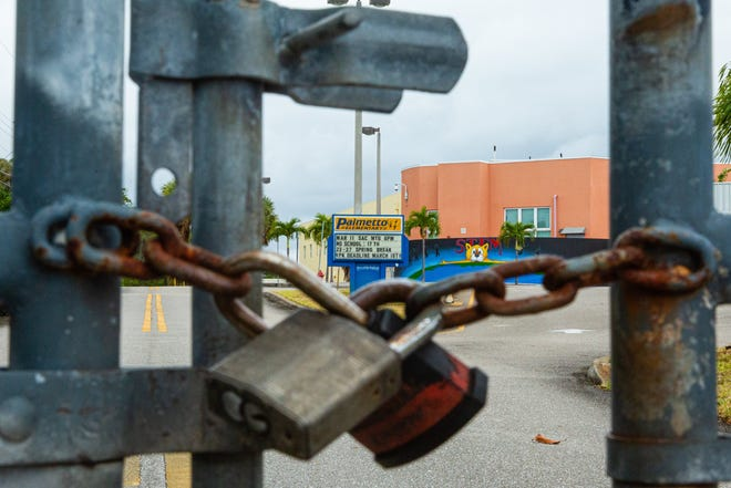 Locked gates at Palmetto Elementary School in West Palm Beach in April. Palm Beach County Schools were closed to students starting in March until the end of the school year. [JOSEPH FORZANO/palmbeachpost.com]