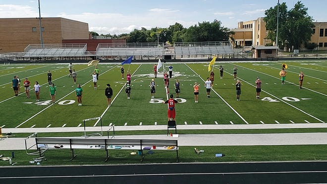 Pratt High School Marching Band practices an Aztec Fire performance under the direction of drum major Dawson Malone in their Latin-themed show. Band camp took place last week on Zerger Field with students observing social distancing and masks as needed.