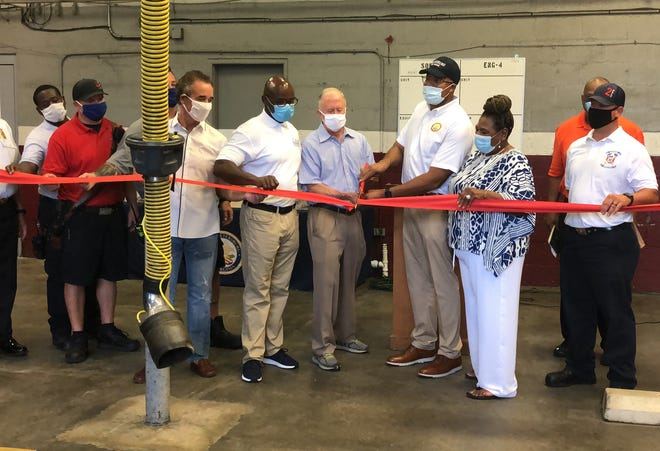 Petersburg City Council members, Sen. Joe Morrissey (D-Richmond) and firefighters and officials cut the ribbon at the reopening event for Fire Station 4 in Petersburg on Saturday, Aug. 29, 2020.
