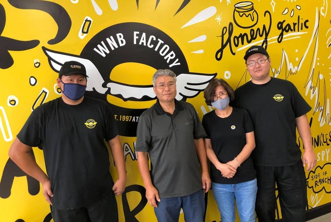 From left to right, WNB Factory owners Peter, Sun, Kyong, and Paul Baik take a break during their grand opening to pose for a photo on Aug. 31, 2020 in Colonial Heights.